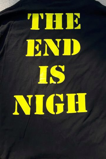 The words THE END IS NIGH on the back of the shirt